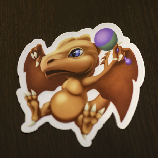 Photograph of the baby dragon sticker available in the Copious Ink Etsy store.