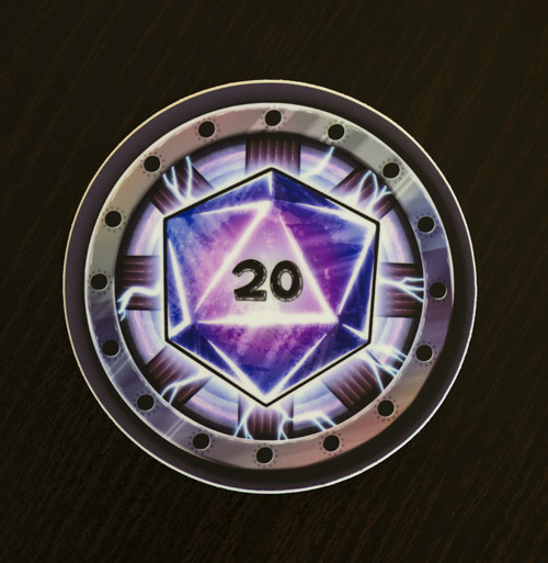 Photo of the D20 arc reactor parody sticker available in the Copious Ink Etsy store.
