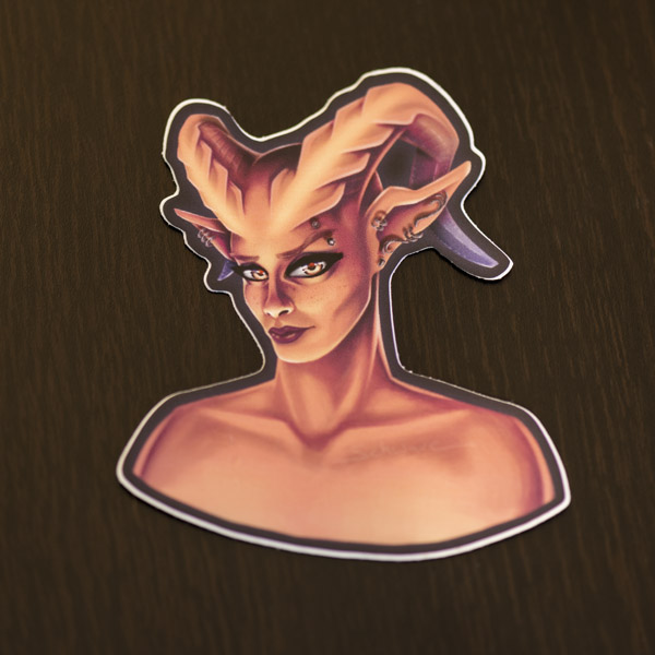 Photograph of the demon lady sticker available in the Copious Ink Etsy store.