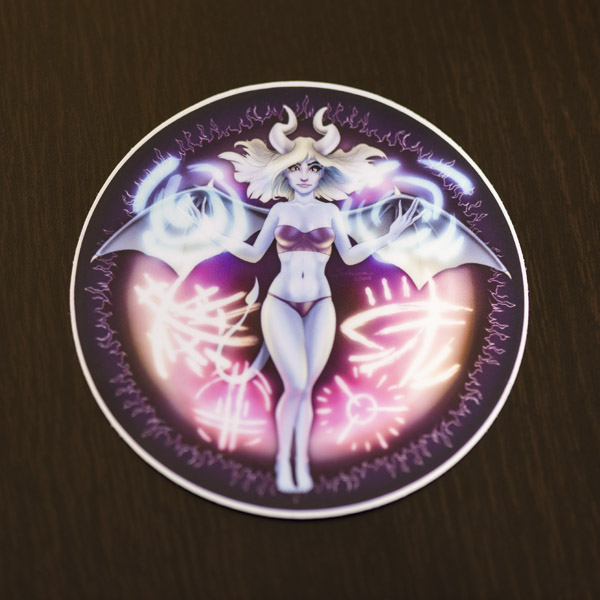 Photograph of the succubus sticker (matte) available in the Copious Ink Etsy store.